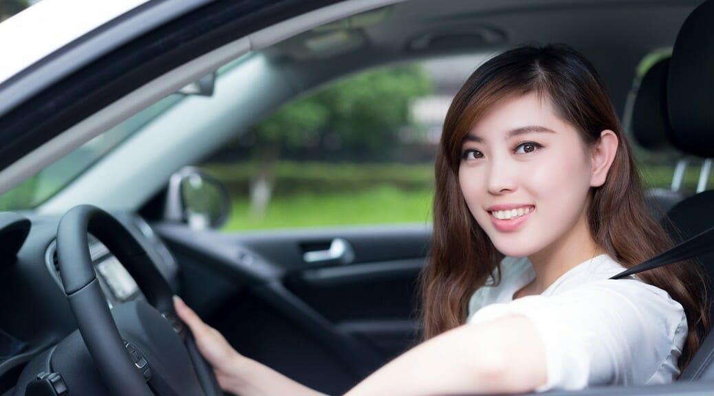 Beautiful young asian woman driving car