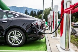 Electric car charging at electric petrol station - E-Mobility