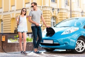 Couple ready to go on electric vehicle