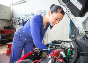 Car mechanic repairing a automobile