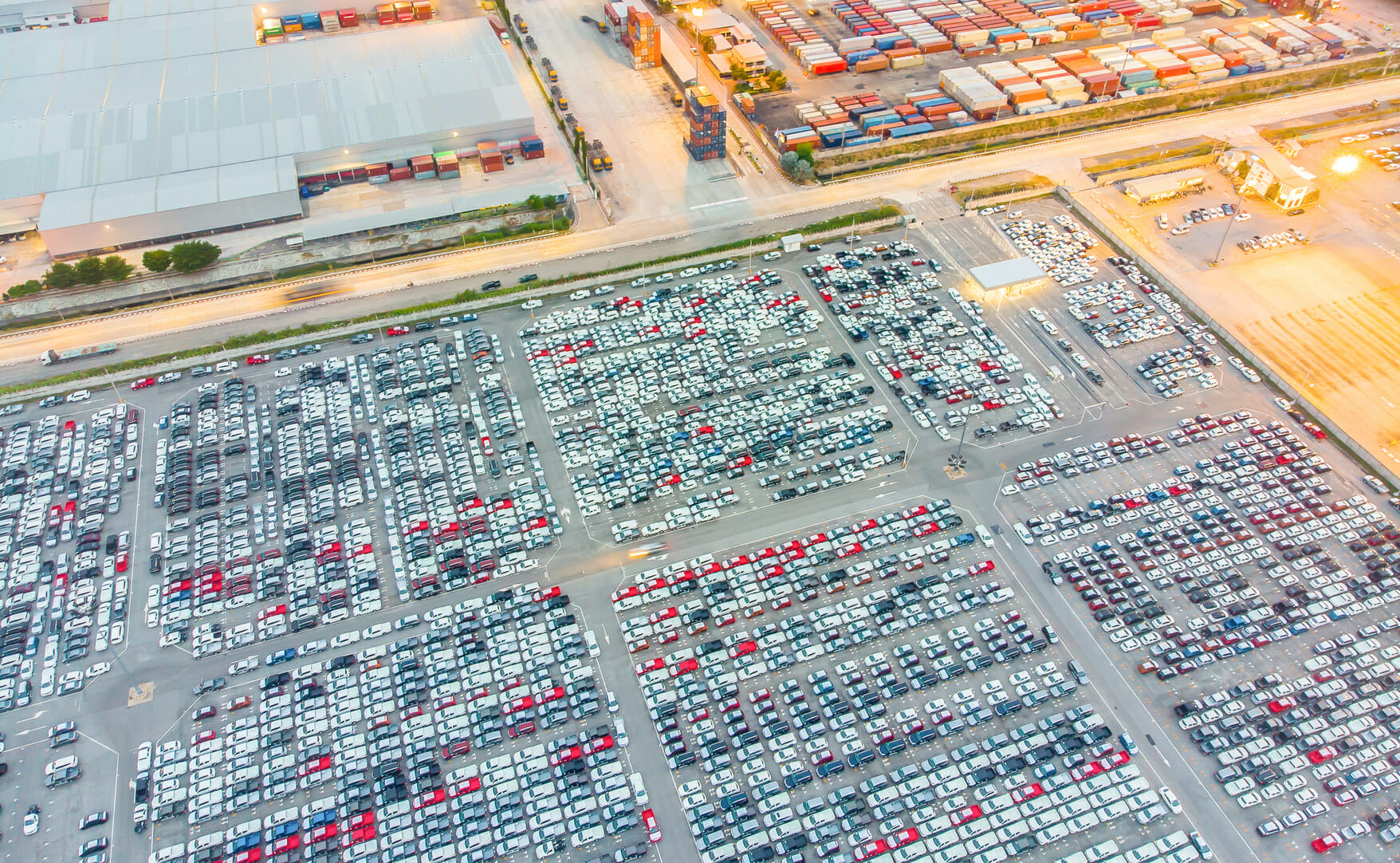 Logistics and transportation of Container Cargo ship and Cargo import/export and business logistics,Aerial view from drone top view new cars lined up in the port for import and export.